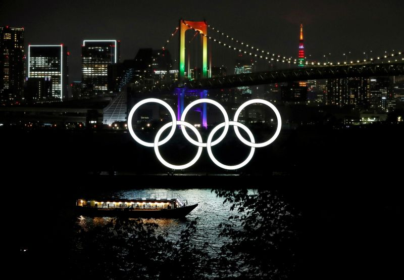 FILE PHOTO: The Rainbow Bridge and Tokyo Tower are illuminated with Olympic colours to mark 100 days countdown to the Tokyo 2020 Olympics in Tokyo
