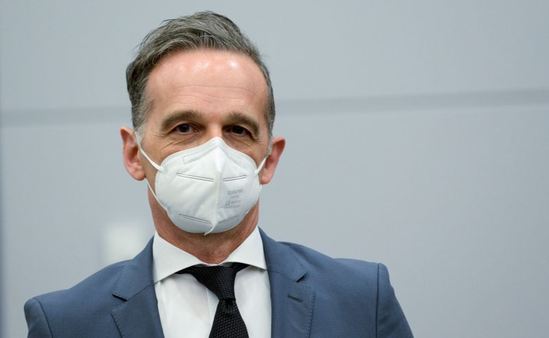 FILE PHOTO: German Foreign Minister Heiko Maas wears a protective mask during a meeting with U.S. Secretary of State Antony Blinken in Brussels,