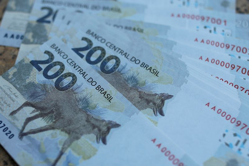 FILE PHOTO: 200 reais note are seen after Brazil's Central Bank issues the new note in Brasilia