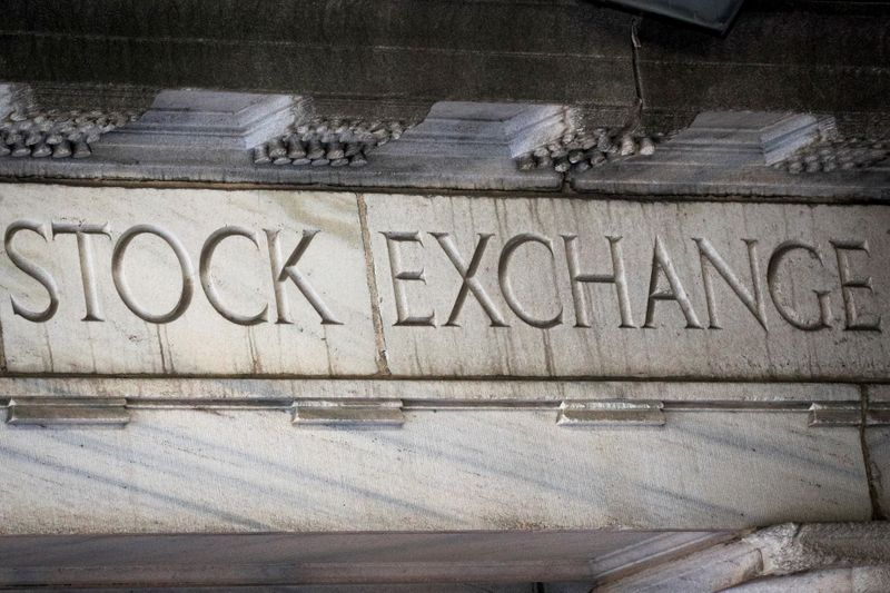 FILE PHOTO: Stock Exchange is seen over an entrance to the NYSE on Wall St. in New York