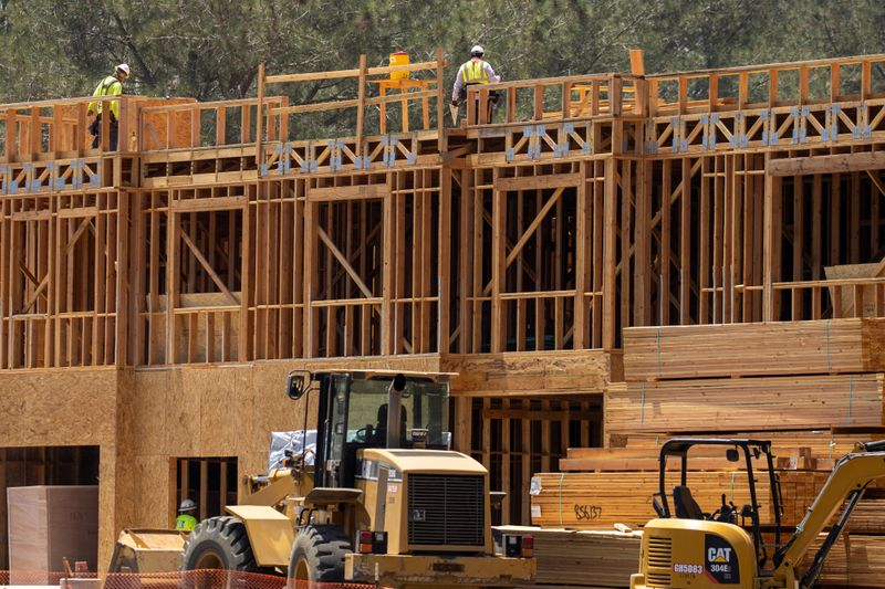 Construction workers on the job at a residential project during the outbreak of the coronavirus disease in California