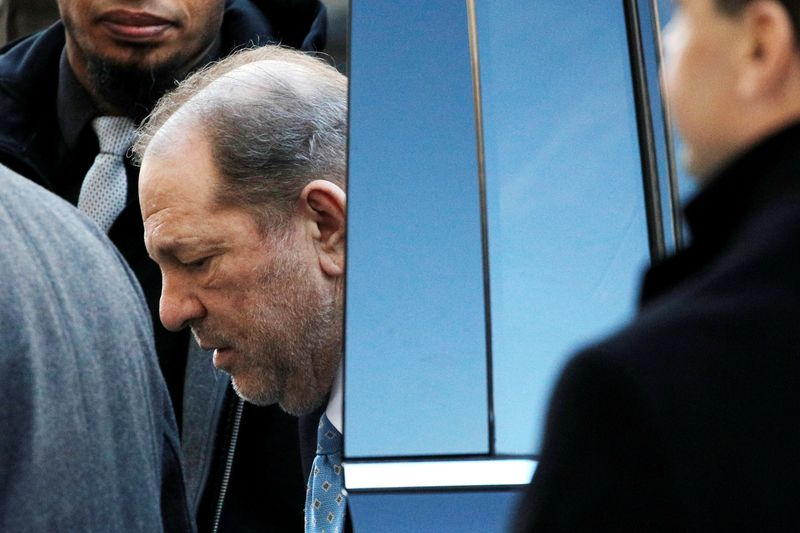 FILE PHOTO: Film producer Harvey Weinstein arrives at New York Criminal Court ahead of the fifth day of jury deliberations for his sexual assault trial in the Manhattan borough of New York City, New York
