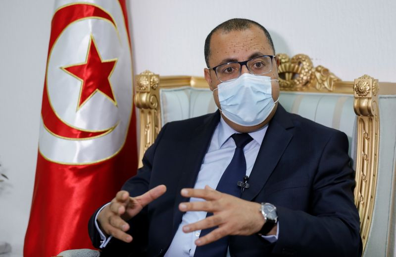 Tunisian Prime Minister Hichem Mechichi speaks during an interview with Reuters in Tunis