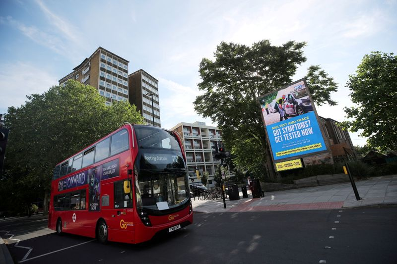 FILE PHOTO: A government and NHS Test and Trace advert is seen on a billboard in London