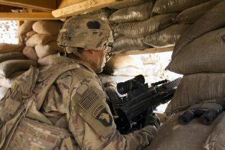 FILE - In this Sept. 8, 2016 file photo, a U.S. Army soldier guards a position at Camp Swift, northern Iraq. Iraq's prime minister asked the Iranian leadership to rein in Iran-backed militias in Iraq, and in a strongly worded message to Tehran, suggested he would confront the factions, two Iraqi officials said Wednesday, April 7, 2021, ahead of another round of strategic talks with Washington. (AP Photo/Susannah George)