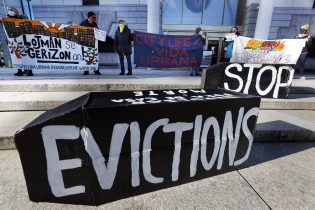 FILE - In this Jan. 13, 2021, file photo, tenants' rights advocates demonstrate in front of the Edward W. Brooke Courthouse in Boston. President Joe Biden's administration is cutting things close on a nationwide eviction moratorium, which is set to expire in less than a week. (AP Photo/Michael Dwyer, File)