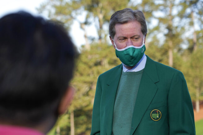Chairman Fred Ridley waits on the first tee for the start of the final round of the Augusta National Women's Amateur golf tournament at Augusta National Golf Club, Saturday, April 3, 2021, in Augusta, Ga. (AP Photo/David J. Phillip)