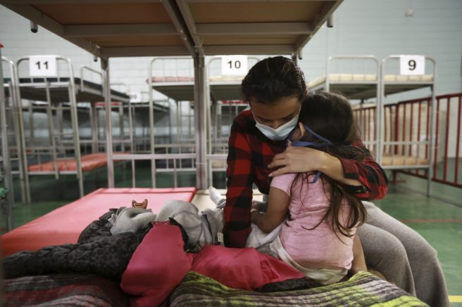 Ana Maria Moreno Portillo from Guatemala embraces her daughter after they were deported from the U.S., at the Kiki Romero Sports Complex in Ciudad Juarez, Mexico, Monday, April 5, 2021. The sports complex was adapted as a shelter because of the growing number of migrants being deported daily. (AP Photo/Christian Chavez)