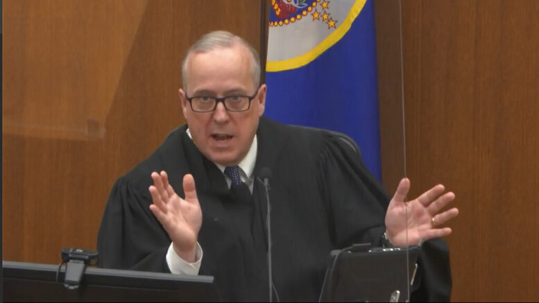 In this image from video, Hennepin County Judge Peter Cahill discusses motions before the court Tuesday, April 6, 2021, in the trial of former Minneapolis police Officer Derek Chauvin, in the May 25, 2020, death of George Floyd at the Hennepin County Courthouse in Minneapolis, Minn. (Court TV via AP, Pool)