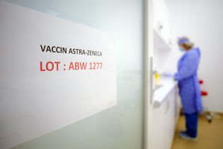 """A door sign shows the batch of AstraZeneca vaccine currently used at a vaccination center in Bucharest, Romania, Wednesday, April 7, 2021. British authorities recommended Wednesday that the AstraZeneca COVID-19 vaccine not be given to adults under 30 where possible because of strengthening evidence that the shot may be linked to rare blood clots, a recommendation that came as regulators both in the United Kingdom and the European Union emphasized that the benefits of receiving the vaccine continue to outweigh the risks for most people — even though the European Medicines Agency said it had found a """"possible link"""" between the shot and the rare clots.(AP Photo/Vadim Ghirda)"""