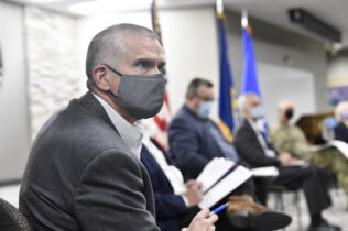 U.S. Rep. Matt Rosendale listens during a roundtable discussion with veterans and other community members on Wednesday, April 7, 2021 at Fort Harrison in Helena, Mont. (Thom Bridge/Independent Record via AP)