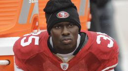 FILE - In this Oct. 17, 2010 file photo, San Francisco 49ers cornerback Phillip Adams (35) sits on the sideline during the first quarter of an NFL football game in San Francisco. A source briefed on a mass killing in South Carolina says the gunman who killed multiple people, including a prominent doctor, was the former NFL pro. The source said that Adams shot himself to death early Thursday, April 8, 2021. (AP Photo/Paul Sakuma, File)