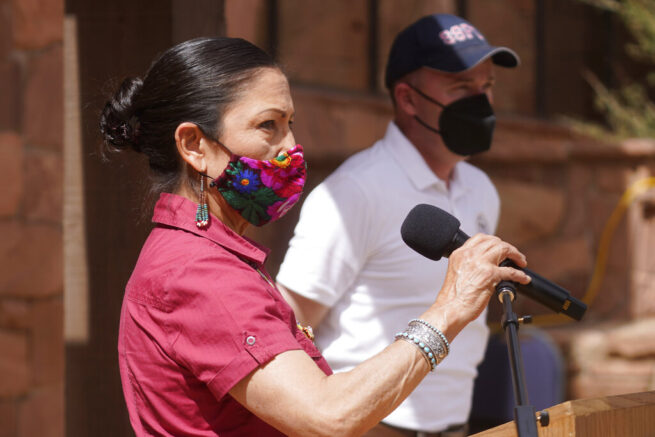 U.S. Interior Secretary Deb Haaland speaks while Utah Gov. Spencer Cox looks on during a news conference following a visit to Bears Ears National Monument Thursday, April 8, 2021, in Blanding, Utah. Haaland is visiting Utah as she prepares to submit a