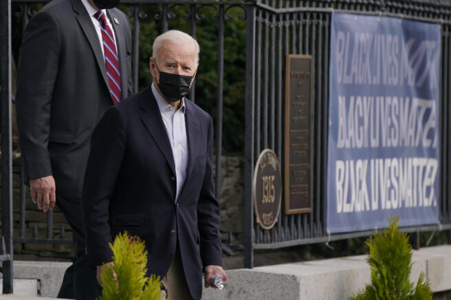 President Joe Biden departs after attending Mass at Holy Trinity Catholic Church in the Georgetown neighborhood of Washington, Saturday, April 10, 2021. (AP Photo/Patrick Semansky)