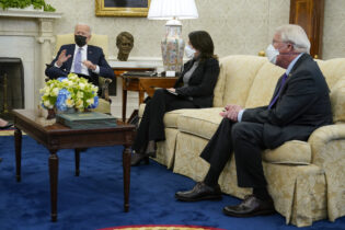 President Joe Biden speaks during a meeting with lawmakers to discuss the American Jobs Plan in the Oval Office of the White House, Monday, April 12, 2021, in Washington. Seated alongside Biden are Sen. Maria Cantwell, D-Wash., and Sen. Roger Wicker, R-Miss. (AP Photo/Patrick Semansky)