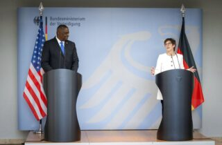 Annegret Kramp-Karrenbauer, Federal Minister of Defence, and US Secretary of Defence Lloyd Austin attend a news conference at the Federal Ministry of Defence in Berlin, Germany, Tuesday, April 13, 2021. This is the first visit to Germany by a minister of the new US administration. Austin will then travel on to Stuttgart, where he will talk to soldiers at the US command centres for troops in Africa and Europe. (Kay Nietfeld/dpa via AP)
