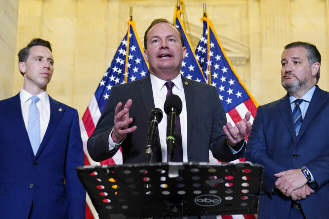 Sen. Mike Lee, R-Utah, center, flanked by Sen. Josh Hawley, R-Mo., left, and Sen. Ted Cruz, R-Texas, right, talks about legislation to end Major League Baseball's special immunity from antitrust laws, during a news conference on Capitol Hill in Washington, Tuesday, April 13, 2021. (AP Photo/Susan Walsh)