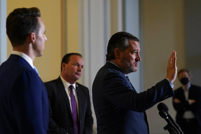 Sen. Ted Cruz, R-Texas, right, standing with Sen. Josh Hawley, R-Mo., left, and Sen. Mike Lee, R-Utah, center, talks about legislation to end Major League Baseball's special immunity from antitrust laws during a news conference on Capitol Hill in Washington, Tuesday, April 13, 2021. (AP Photo/Susan Walsh)