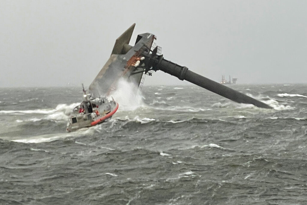 A Coast Guard Station Grand Isle 45-foot Respone Boat-Medium boatcrew heads toward a capsized 175-foot commercial lift boat Tuesday, April 13, 2021, searching for people in the water 8 miles south of Grand Isle, Louisiana. The Coast Guard and multiple other boats rescued six people onboard a commercial lift boat that capsized off the coast of Louisiana on Tuesday night and were searching for more, the agency said.(U.S. Coast Guard Coast Guard Cutter Glenn Harris via AP)