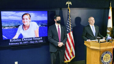 San Luis Obispo District Attorney Dan Dow announces a murder charge is filed against Paul Flores in the Kristin Smart case, as Deputy District Attorney Chris Peuvrelle listens at left, during a news conference, Wednesday, April 14, 2021, in Arroyo Grande, Calif. Smart, a missing California college who was killed in 1996 during an attempted rape by a fellow student, and the suspect's father helped hide her body, the San Luis Obispo County district attorney said Wednesday. (David Middlecamp/The Tribune (of San Luis Obispo) via AP)