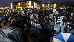 Demonstrators gather during a protest over Sunday's fatal shooting of Daunte Wright during a traffic stop, outside the Brooklyn Center Police Department, Wednesday, April 14, 2021, in Brooklyn Center, Minn. (AP Photo/John Minchillo)
