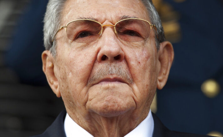 FILE - In this March 17, 2015 file photo, Cuba's President Raul Castro listens to the Cuban and Venezuelan national anthems during his welcome ceremony at the Miraflores presidential palace in Caracas, Venezuela. On Friday, April 16, 2021, Castro formally announced he'd step down as head of the Communist Party, leaving Cuba without a Castro in an official position of command for the first time in more than six decades. (AP Photo/Ariana Cubillos, File)