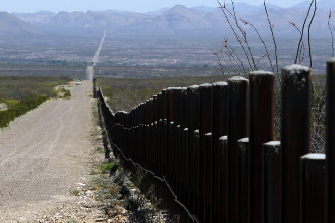 FILE - In this March 18, 2016, file photo, a U.S. Customs and Border Patrol truck patrols the U.S. border with Mexico in Douglas, Ariz. Migrants trekking across the Arizona borderlands have died at higher rates in the two decades since stepped up enforcement began funneling them into remote, hostile desert and mountain regions, a sweeping new analysis concluded Monday, April 19, 2021. (AP Photo/Ricardo Arduengo, File)