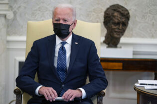 """President Joe Biden speaks during a meeting with members of the Congressional Hispanic Caucus, in the Oval Office of the White House, Tuesday, April 20, 2021, in Washington. Biden said Tuesday that he is """"praying the verdict is the right verdict"""" in the trial of former Minneapolis Police Officer Dereck Chauvin. (AP Photo/Evan Vucci)"""