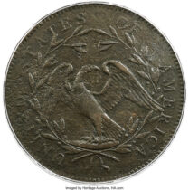 """This undated photo provided by Heritage Auctions shows the back of a piece of copper that was struck by the U.S. Mint in Philadelphia in 1794 and was a prototype for the fledgling nation's money. The item, which is known as the """"No Stars Flowing Hair Dollar,"""" is owned by businessman and Texas Rangers co-chairman Bob Simpson and will go up for auction at Heritage Auctions in Dallas on Friday, April 23, 2021. (Emily Clements/Heritage Auctions via AP)"""