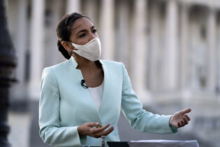 Rep. Alexandria Ocasio-Cortez D-N.Y., speaks during a television interview on Capitol Hill in Washington, Tuesday, April 20, 2021, after the jury returned guilty verdicts on all three charges in the murder trial of former Minneapolis police officer Derek Chauvin in the death of George Floyd. (AP Photo/Jose Luis Magana)