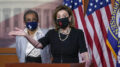 In this April 21, 2021, photo, House Speaker Nancy Pelosi, D-Calif., joins Del. Eleanor Holmes-Norton, D-D.C., left, at a news conference ahead of the House vote on H.R. 51, the Washington, DC Admission Act, on Capitol Hill in Washington. Proponents of statehood for Washington, D.C., face a milestone moment in their decades-long movement to reshape the American political map. (AP Photo/J. Scott Applewhite)