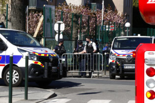 Police officers block the access with barriers next to the Police station in Rambouillet, south west of Paris, Friday, April 23, 2021. A French police officer was stabbed to death inside her police station Friday near the famed historic Rambouillet chateau, and her attacker was shot and killed by officers at the scene, authorities said. The identity and the motive of the assailant were not immediately clear, a national police spokesperson told The Associated Press. The police officer was a 49-year-old administrative employee in the station, the spokesperson said. (AP Photo/Michel Euler)