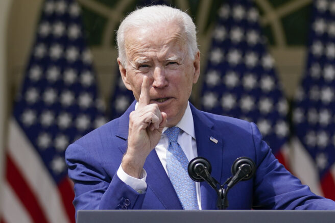 FILE - In this April 8, 2021, file photo President Joe Biden gestures as he speaks about gun violence prevention in the Rose Garden at the White House in Washington. Biden will mark his 100th day in office on Thursday, April 29. (AP Photo/Andrew Harnik, File)