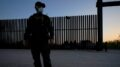 "A U.S. Customs and Border Protection agent looks on near a gate on the U.S.-Mexico border wall as agents take migrants into custody, Sunday, March 21, 2021, in Abram-Perezville, Texas. The fate of thousands of migrant families who have recently arrived at the Mexico border is being decided by a mysterious new system under President Joe Biden. U.S. authorities are releasing migrants with ""acute vulnerabilities"" and allowing them to pursue asylum. But it's not clear why some are considered vulnerable and not others. (AP Photo/Julio Cortez)"