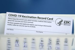 A vaccination record card is shown during a COVID-19 vaccination drive for Spring Branch Independent School District education workers Tuesday, March 16, 2021, in Houston. School employees who registered were given the Pfizer vaccine.(AP Photo/David J. Phillip)