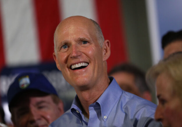 HIALEAH, FLORIDA - NOVEMBER 05:  Florida governor and Republican senatorial candidate Rick Scott addresses the crowd as he attends a Get out the Vote Rally at AmeriKooler on November 05, 2018 in Hialeah, Florida. Governor Scott is facing off against Sen. Bill Nelson (D-FL) on election day. (Photo by Joe Raedle/Getty Images)