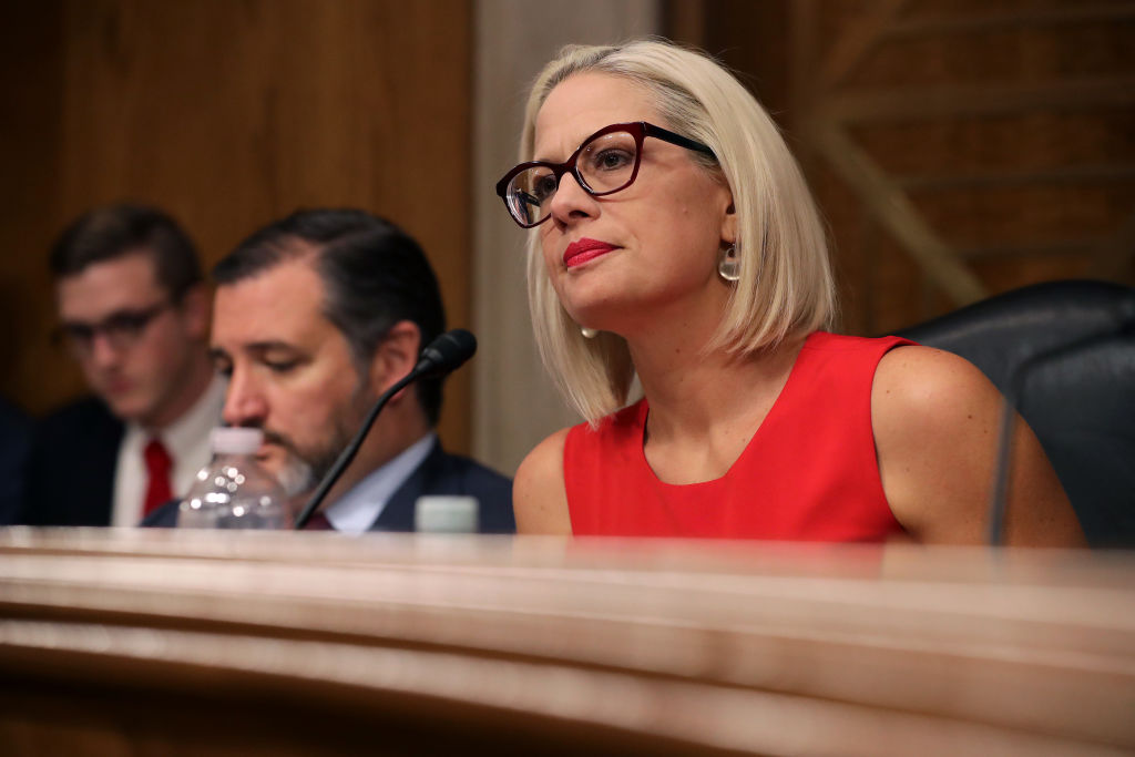 "WASHINGTON, DC - MAY 14: Senate Aviation and Space Subcommittee ranking member Sen. Kyrsten Sinema questions witnesses during a hearing in the Dirksen Senate Office Building on Capitol Hill on May 14, 2019 in Washington, DC. In the wake of President Donald Trump's orders to create a military Space Force, NASA Administrator Jim Bridenstine testified about ""The Emerging Space Environment: Operational, Technical, and Policy Challenges."" (Photo by Chip Somodevilla/Getty Images)"