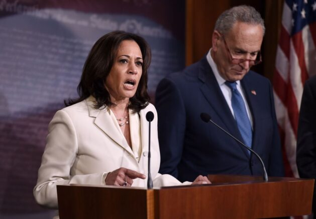 Senator Kamala Harris (D-CA) (L), flanked by Senate Minority Leader Chuck Schumer, speaks about the the Senate Impeachment trial at the US Capitol, January 16, 2020, in Washington, DC. - Members of the US Senate were sworn in on January 16 to serve as jurors at the historic impeachment trial of President Donald Trump. (Photo by OLIVIER DOULIERY / AFP) (Photo by OLIVIER DOULIERY/AFP via Getty Images)