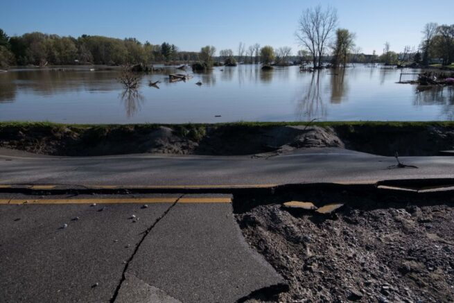A washed out West Saginaw Road in Sanford, Michigan, on May 21, 2020, after the area saw heavy flooding and damage from heavy rains throughout central Michigan . - More than 10,000 residents were evacuating their homes in Michigan on May 20, 2020 after two dams failed following heavy rains triggered what officials warned will be historic flooding. Governor Gretchen Whitmer declared a state of emergency in Midland County, site of the breached dams, in the towns of Edenville and Sanford. (Photo by SETH HERALD / AFP) (Photo by SETH HERALD/AFP via Getty Images)