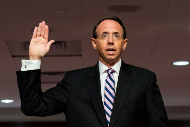 "WASHINGTON, DC - JUNE 03: Former U.S. Deputy Attorney General Rod Rosenstein is sworn in at a hearing of the Senate Judiciary Committee on Capitol Hill on June 03, 2020 in Washington, DC. The Republican-led panel is exploring issues raised with warrants issued in the FBI investigation, code named ""Crossfire Hurricane"" at the time, of Trump campaign officials in the 2016 presidential race. (Photo by Jim Lo Scalzo-Pool/Getty Images)"