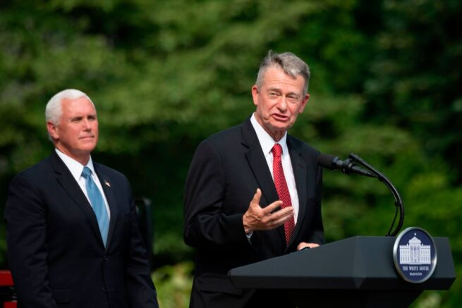 US Vice President President Mike Pence(L) listens as Idaho Governor Brad Little(R-ID) speaks at the White House in Washington, DC, on July 16, 2020, during an event on Rolling Back Regulations to Help All Americans on the South Lawn at the White House on July 16, 2020 in Washington,DC. (Photo by JIM WATSON / AFP) (Photo by JIM WATSON/AFP via Getty Images)