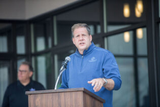 MANCHESTER, NH - SEPTEMBER 13: New Hampshire Governor Christopher Sununu delivers remarks during the ribbon cutting ceremony for the grand opening of DraftKings Sportsbook Manchester on September 2, 2020 in Manchester, New Hampshire. (Photo by Scott Eisen/Getty Images for DraftKings)