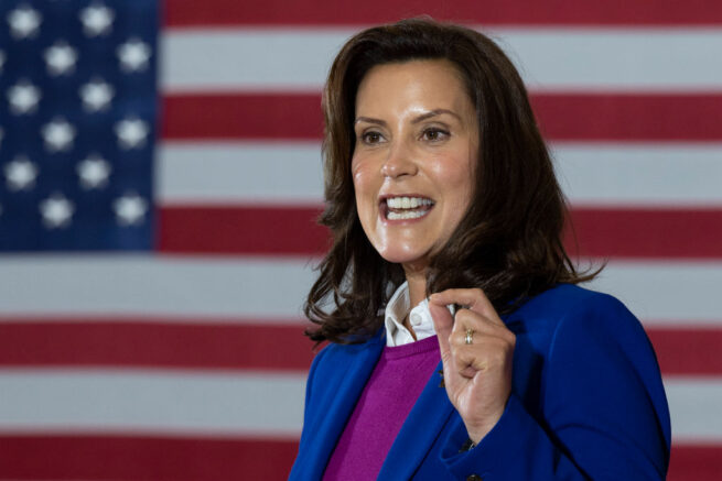"""Michigan Governor Gretchen Whitmer introduces Democratic Presidential Candidate Joe Biden to speak at Beech Woods Recreation Center in Southfield, Michigan, on October 16, 2020. - Joe Biden on October 16, 2020 described President Donald Trump's reluctance to denounce white supremacists as """"stunning"""" in a hard-hitting speech in battleground Michigan with 18 days to go until the election. (Photo by JIM WATSON / AFP) (Photo by JIM WATSON/AFP via Getty Images)"""
