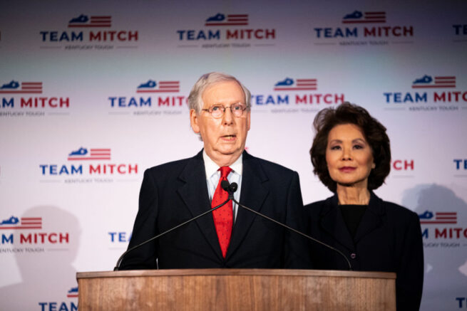 LOUISVILLE, KY - NOVEMBER 03: Senate Majority Leader Mitch McConnell (R-KY), delivers his victory speech next to his wife, Elaine Chao, at the Omni Louisville Hotel on November 3, 2020 in Louisville, Kentucky. McConnell has reportedly defeated his opponent, Democratic U.S. Senate candidate Amy McGrath, marking his seventh consecutive U.S. Senate win. (Photo by Jon Cherry/Getty Images)