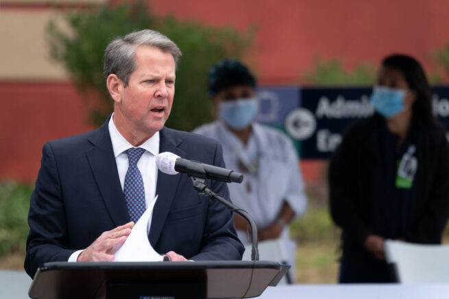 SAVANNAH, GA - DECEMBER 15: Georgia Gov. Brian Kemp speaks to the media before health care workers receive the Pfizer-BioNTech COVID-19 vaccine outside of the Chatham County Health Department on December 15, 2020 in Savannah, Georgia. Kemp was on hand to witness initial administering of vaccines in the state. (Photo by Sean Rayford/Getty Images)