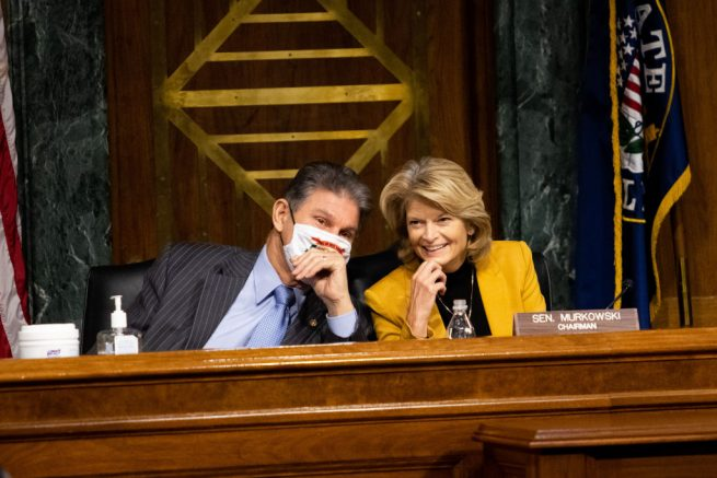 WASHINGTON, DC - JANUARY 27: Chairwoman Sen. Lisa Murkowski (R-AK) confers with Sen. Joe Manchin (D-WV) during the confirmation hearing for Secretary of Energy nominee Jennifer Granholm before the Senate Committee on Energy and Natural Resources on Capitol Hill January 27, 2021 in Washington, DC. Granholm was Governor of Michigan from 2003-2011. (Photo by Graeme Jennings-Pool/Getty Images)