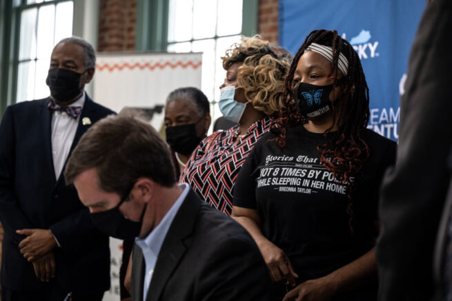 LOUISVILLE, KY - APRIL 09: Tamika Palmer, Breonna Taylor's mother, cries and watches as Kentucky Gov. Andy Beshear signs SB4 into law at the Center for African American Heritage on April 9, 2021 in Louisville, Kentucky. SB4 places more restrictions on no-knock raids and limits police departments power to use them. This bill comes as a response to the killing of Breonna Taylor during the execution of a no-knock warrant on March 13, 2020. (Photo by Jon Cherry/Getty Images)