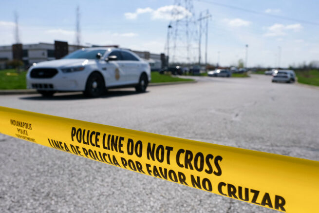 "Police caution tape blocks the entrance to the site of a mass shooting at a FedEx facility in Indianapolis, Indiana on Friday, April 16, 2021. - A gunman has killed at least eight people at the facility before turning the gun on himself in the latest in a string of mass shootings in the country, authorities said. The incident came a week after President Joe Biden branded US gun violence an ""epidemic"" and an ""international embarrassment"" as he waded into the tense debate over gun control, a powerful political issue in the US. (Photo by Jeff Dean / AFP) (Photo by JEFF DEAN/AFP via Getty Images)"