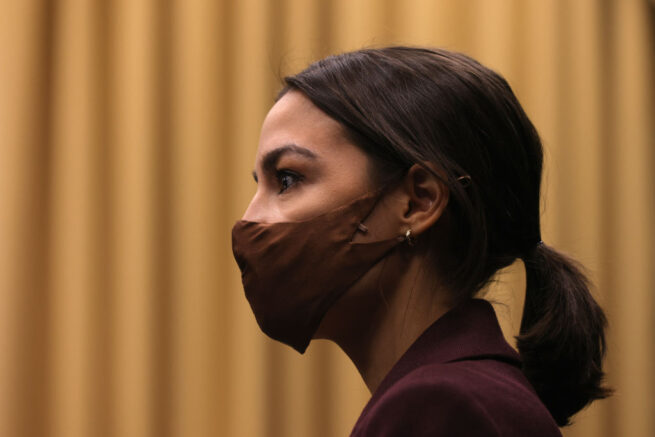 """WASHINGTON, DC - MARCH 18: U.S. Rep. Alexandria Ocasio-Cortez (D-NY) listens during a news conference to introduce the """"Puerto Rico Self-Determination Act of 2021"""" at Rayburn House Office Building on Capitol Hill March 18, 2021 in Washington, DC. (Photo by Alex Wong/Getty Images)"""