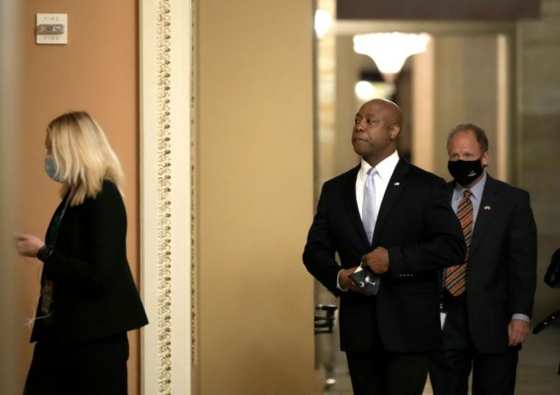 WASHINGTON, DC - APRIL 28: Sen. Tim Scott (R-SC) walks through the U.S. Capitol before he delivers the republican response to President Biden's address to congress April 28, 2021 in Washington, DC. On the eve of his 100th day in office, Biden spoke about his plan to revive America's economy and health as it continues to recover from a devastating pandemic. He delivered his speech before 200 invited lawmakers and other government officials instead of the normal 1600 guests because of the ongoing COVID-19 pandemic. (Photo by Drew Angerer/Getty Images)